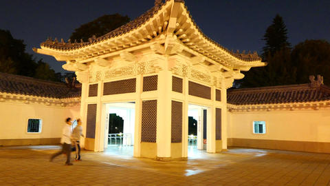 Traditional Chinese pavilion at night, parallax shot of white construction Footage