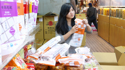 Girl stamping packs with meals. Boy helping her, take out ready packs Footage
