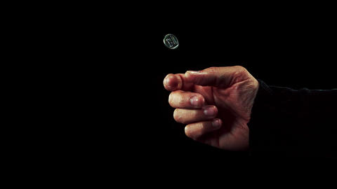 Hand tossing a coin ライブ動画