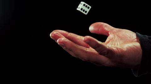 Hand catching a dice Stock Video Footage