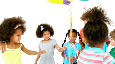 Happy children playing with balloons Footage