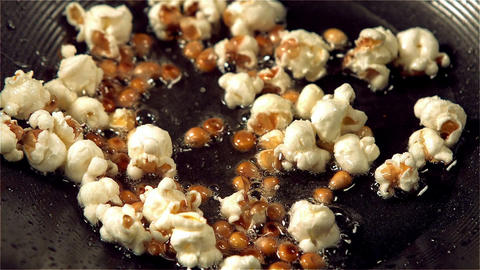 Popcorn popping in hot oil Live Action