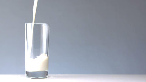 Milk pouring into a glass Footage