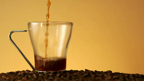 Coffee pouring into a glass cup Footage