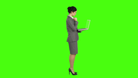 Business woman standing and using a laptop Footage