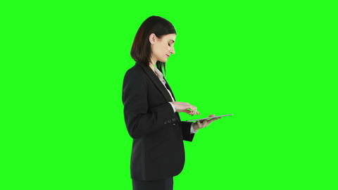 Business woman standing and using a tablet Footage