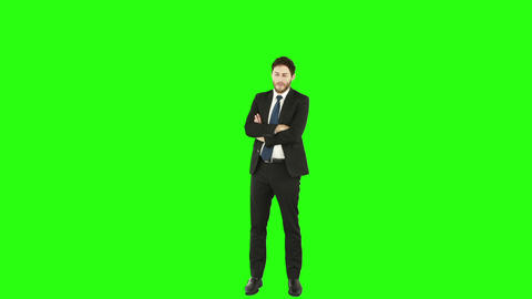 Standing businessman with arms crossed Footage