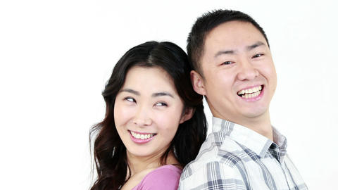 Smiling couple showing their thumbs at the camera Footage
