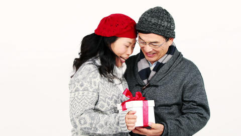Happy Asian couple holding a present Footage