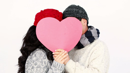 Mature Asian couple covering their face wit a pillow heart Footage