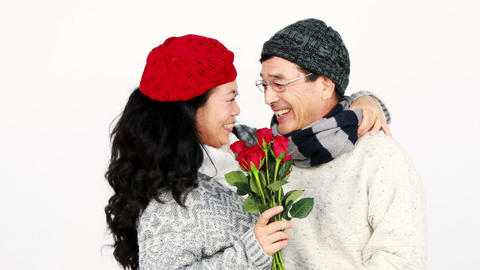 Asian man giving roses to his wife Footage