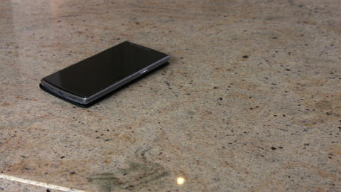 Smartphone on the counter Live Action