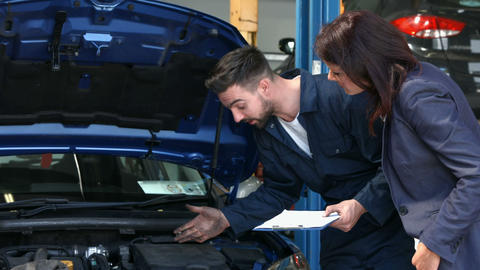 Mechanic talking to a female customer Footage