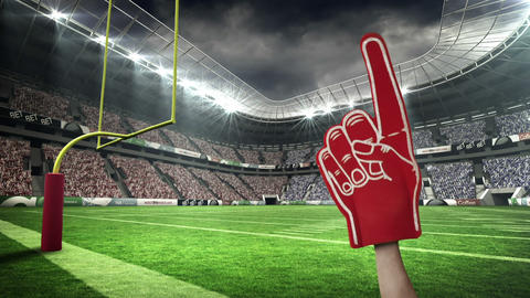 Supporters waving foam finger Live Action