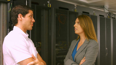 Technicians talking in the server room Footage
