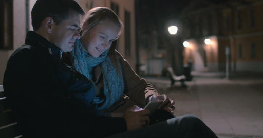 Couple Sitting on the Bench with Tablet Footage