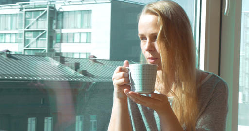 Woman Drinking Morning Tea by Window Footage