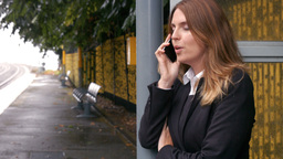 Businesswoman waiting for a train on the phone Footage