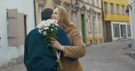 Man Giving Bunch of Flowers to Woman Footage
