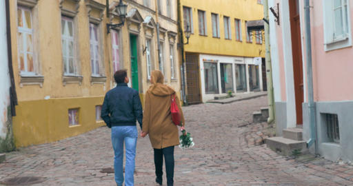 Loving couple having a walk in old empty street Footage
