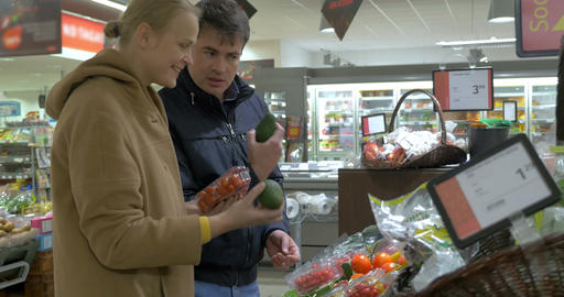 Couple Choosing Vegetables in Supermarket Footage
