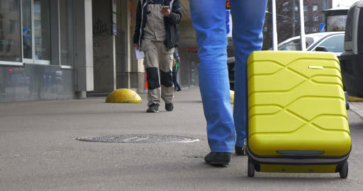 Man With A Suitcase On Wheels In The City Street Footage