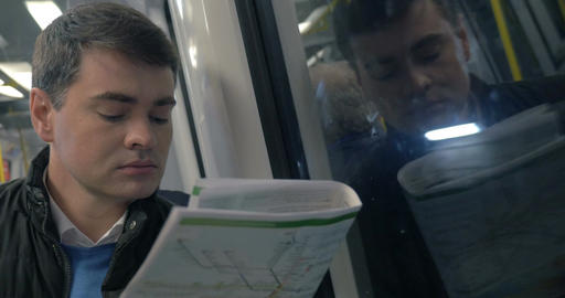 Man with newspaper traveling in metro train Footage