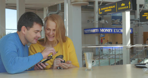 Happy Adult Couple With Smart Phones Footage