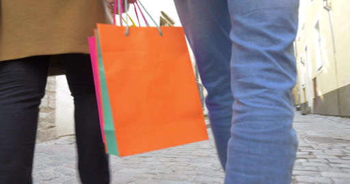 People Walking in Tallinn with Shopping Bags Footage