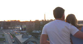 Romantic Couple On The Balcony Look At The City At Sunset Stock Video Footage