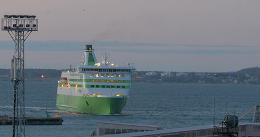 Cruise ship sailing to port in the evening Footage