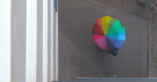 Pedestrian Twists Colored Umbrella Footage