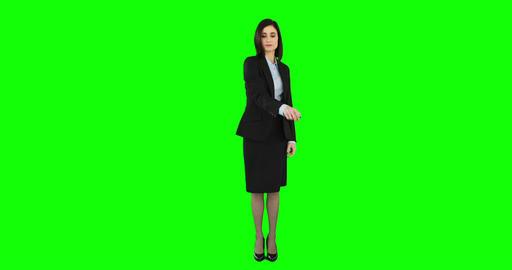 Unsmiling businesswoman pointing at screen Footage