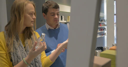Man and Woman Trying Fragrances in Perfumery Shop Stock Video Footage