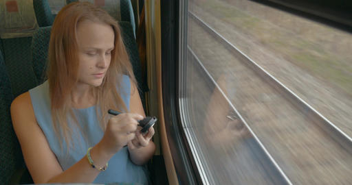 Woman with Pocket-Glass in Train Live Action