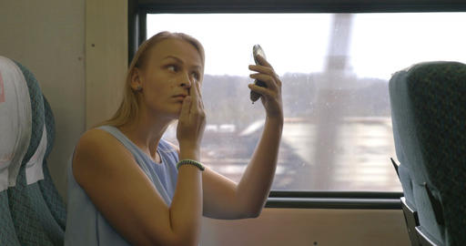 Woman Applying Make-up in Train Footage