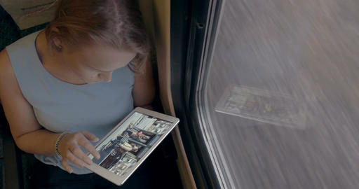 Woman Using Her Tablet In The Train Footage
