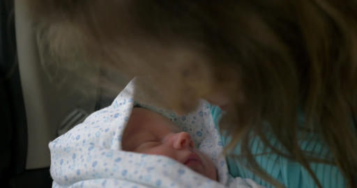 New born baby sleeping in mothers hands Footage