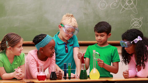 Pupils at science lesson in classroom Footage