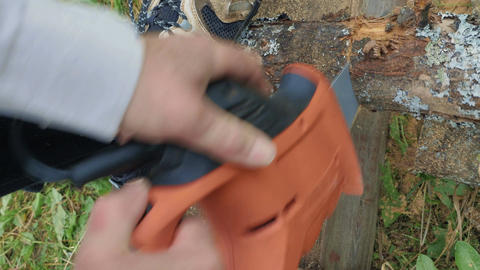 Man sawing the wood with electric tool Footage