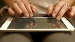 Businesswoman hands working on a tablet Live Action