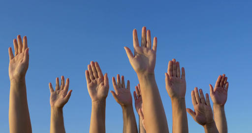 Raised hands against blue sky Footage