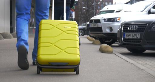 Man Rolling Yellow Trolley Bag Footage