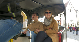 Man and woman going sightseeing by bicycle taxi Footage