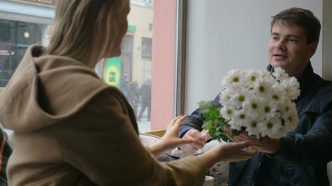 Man Giving Flowers to Woman Footage