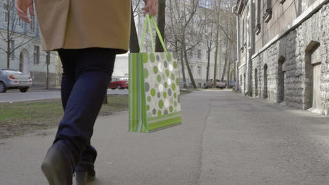 Woman Legs Walking With Colorful Shopping Bag Footage