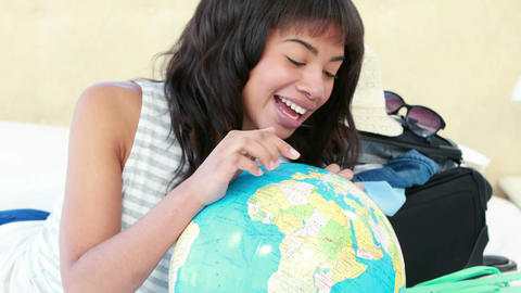 Smiling woman pointing globe Footage