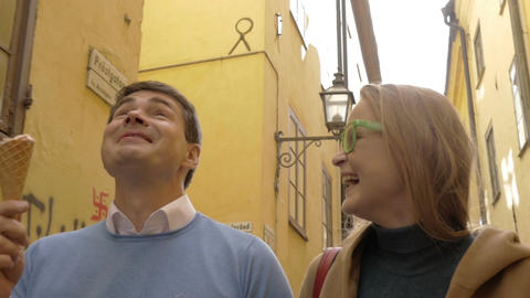 Happy man and woman eating ice-cream during a walk Footage