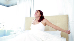 Smiling woman waking up Footage