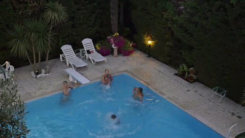 Family in the swimming pool on resort Footage